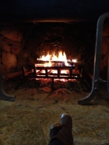 sitting by one of the fireplaces in the lobby -- just chillin'